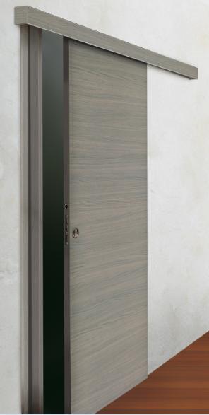 דלת הזזה הנגררת על קיר חיצוני מתאימה לחללים קטנים, בולטת מפני הקיר רק 5 ס